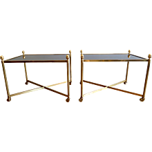 A pair of French Brass side tables
