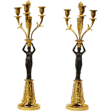 A pair of gilt bronze and patinated candelabra, possibly Germany.