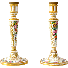 A Pair of Gilt and Painted Porcelain Candlesticks. 19th Century.
