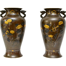 A Pair of Japanese Meiji Mixed Metal Relief Vases