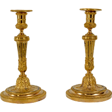 A Pair of Louis XVI Gilt Bronze Candlesticks.