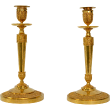 A Pair of Early Empire Gilt Bronze Candlesticks