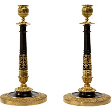 A Pair of Gilt and Patinated Bronze Candlesticks, Early 19th Century
