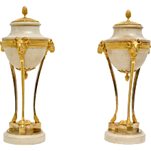 A Pair of Louis XVI Gilt Bronze and White Marble Urns.