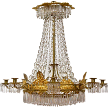 A French Empire Gilt Bronze and Crystal Chandelier. Circa 1825. Signed