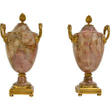 An Important Pair of Louis XVI Ormolu Mounted Pink Alabaster Urns..
