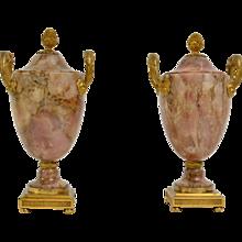 A Pair of Louis XVI Ormolu Mounted Pink Alabaster Urns
