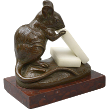 A 19thC French bronze sculpture of a mouse eating cheese, signed by C. Masson.