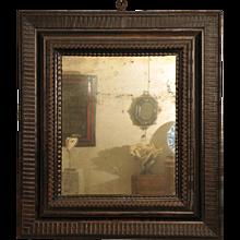 Franco-Flemish ebonized kingwood mirror.