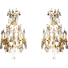 An exquisite pair of gilded bronze and rock crystal Louis XVI style chandeliers