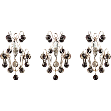A set of three silvered 'ball' chandeliers