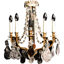 A pair of 18 carat gilded Louis XVI style wall lights