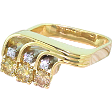 Modernist Fancy Deep Yellow & White Brilliant Cut Diamond Trilogy Ring, dated 1978