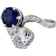 Art Deco 1.90 Carat Natural Sapphire & 1.59 Carat Old Cut Diamond Crossover Ring, circa 1925