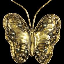 a butterfly brass bronze sconce circa 1960