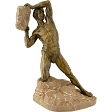 Antique bronze male nude with rock, 1900