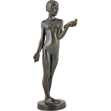 Frech Art Deco bronze of a young girl holding a dove by Henry Arnold, 1928