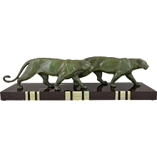 French Art Deco sculpture of two walking panthers. Alexandre Ouline, 1930