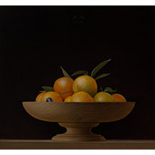 Tangerines in a wooden bowl on a table