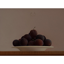 Plums on a writing desk