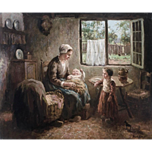 Mother with baby in her lap while little girl is watching