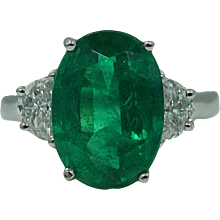 Platinum Oval Emerald and Diamond Ring