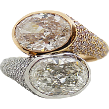 6.22 Carat Oval and Round Diamond Rose Gold and Platinum Ring