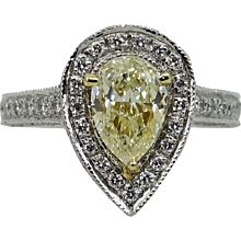 Platinum Light Yellow Pear Shaped Diamond and Round Diamond Ring