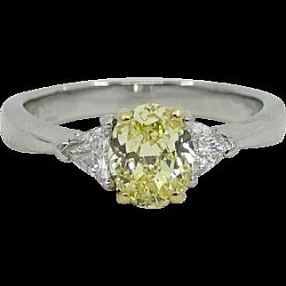 Oval Brilliant Fancy Intense Yellow Diamond Platinum White Gold Ring