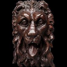 An Elizabeth I Carved Oak Lion Mask Mount