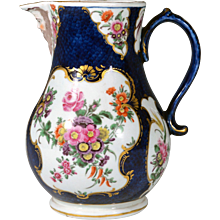 First Period Worcester Porcelain Large Blue Scale Botanical Mask Jug, Circa 1765.