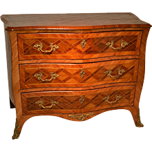 Louis XV parquetry commode with ormolu mounts, 18th century