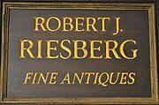 Robert J. Riesberg Antiques logo