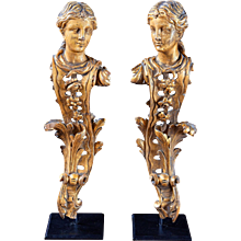 A Carved Pair of English Giltwood Architectural Corner Mounts