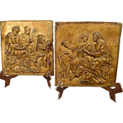 A Pair of Italian Gilt Lead Plaques