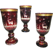 Group of Three Large Ruby Red Bohemain Glass Goblets