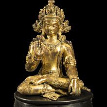 A figure of a Bodhisattva, Gilt Bronze with semi-precious stone inlay, Nepal, 14th century