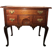 An English Queen Anne Mahogany Side Table
