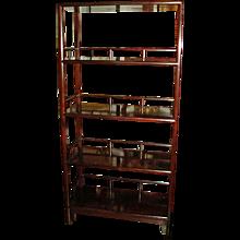 A Polished Mahogany Bookshelf with four shelves, from Hong Kong