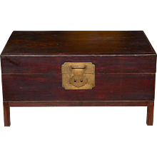 A Chinese Lacquered Wood Trunk on Stand