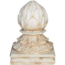 A large white marble carpet weight from India
