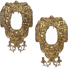 Pair of Continental Polished Brass Repoussé Mirrored Sconces
