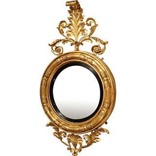Late Regency Giltwood and Ebonised Convex Mirror