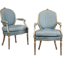 A Pair of George III Period Gilt and White Painted Elbow Chairs attributable to Thomas Chippendale