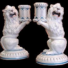 A Pair of Lion Form Candlesticks