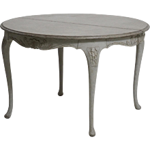 Swedish Rococo style extension table, richly carved, with finely carved apron, with carving on the two leafs too, circa 100 years old.