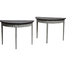 A pair of richly carved Gustavian demi-lune console table, 19th C.