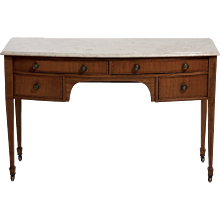 An American sideboard in satin wood with original locks and bronze hardware, circa 1820. Marble top.