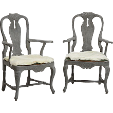 Pair of Swedish Rococo style carved armchairs, 19th C.