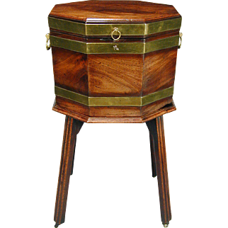 George III mahogany brass banded cellarette on stand with moulded legs and original castors. England, c.1780.